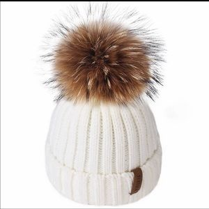 Beautiful kids hat. With real raccoon fur.